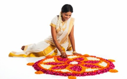 Indian woman with Rangoli of Flowers